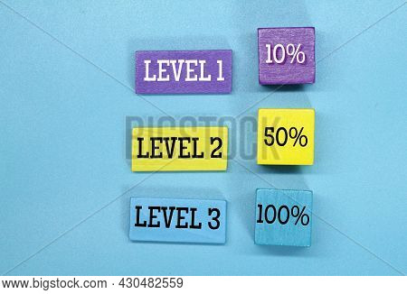 Colored Cubes With The Words Level 1, Level 2 And Level 3
