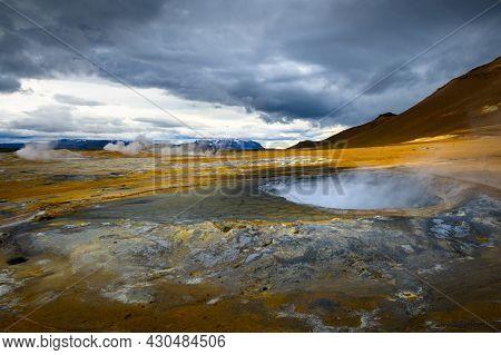 Steaming Mud Pool In The Hverir Geothermal Area In Iceland