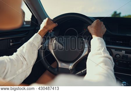 Hand On Steering Wheel Of Expensive Car