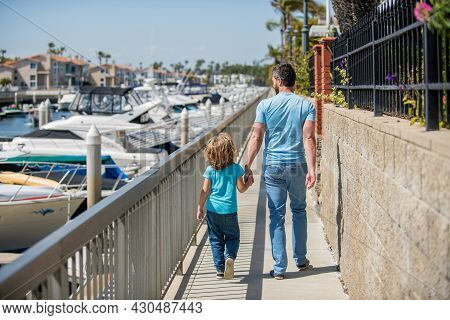 Parent With Small Child Boy. Dad With Kid On Summer Day. Parenting And Fatherhood. Back View.