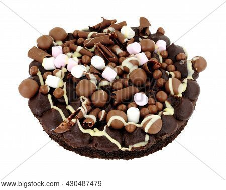 Chocolate Rocky Road Dessert Sponge Cake Decorated With Chocolate Balls And Marshmallows Isolated On