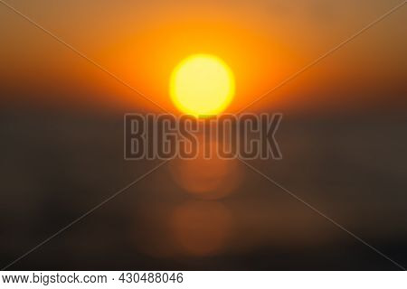The Summer Sun Is A Blurry Sunset Background. Hot Sultry Background For Summer Design. Beautiful Bok