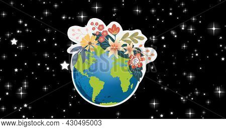 Composition of globe with flowers on starry night sky background. global conservation and earth day concept digitally generated image.