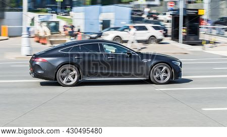 Mercedes-amg Gt 4-door Coupe In Fast Motion On City Street. Speeding In The City Is Not Permissible.