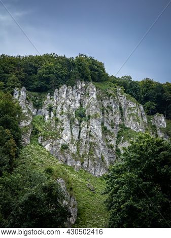 A Picturesque Limestone Rock Formation, Surrounded With Trees.  Ojcow, Polish Jura, Poland.