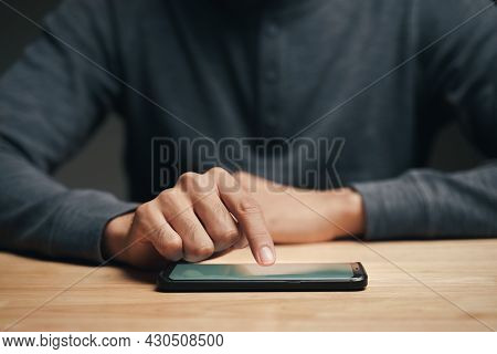 Closeup Of A Man Using A Smartphone On The Wooden Table, Searching, Browsing, Social Media, Message,