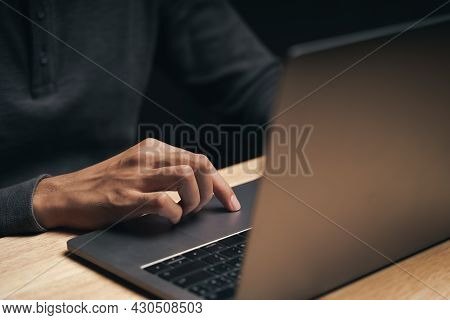Closeup Of A Man Using A Laptop Computer On The Wooden Table, Searching, Browsing, Social Media, Mes