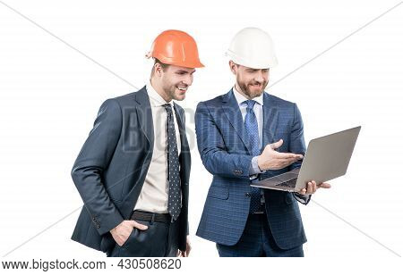 Two Businesspeople Men Partners In Suit And Safety Helmet Work On Laptop Online, Business Partners.