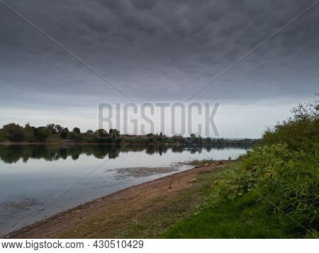 Landscape Of Sava River During Cloudy Day With Mammatus Clouds In Sky