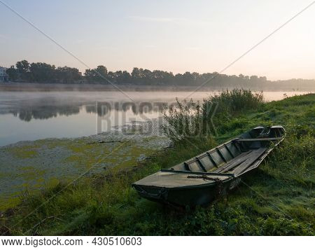 Landscape With Sava River And Stranded Boat On Riverbank During Beautiful Foggy Autumn Morning