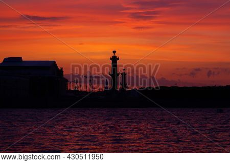 Sunset On The Neva River In Saint Petersburg. View Of The Rostral Columns. Sunset In St. Petersburg.