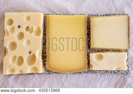 Cheese Collection, Hard French Cheeses Comte And Emmentaler With Round Holes Made From Cow Milk