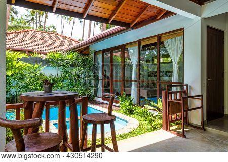 Tangalle, Sri Lanka - Nov 4, 2017: Luxury Villa Among Palm Trees, Swimming Pool With Tropical Garden