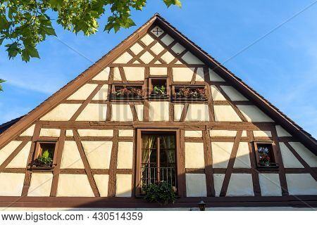 Half-timbered House In South Germany, Europe. Beautiful Facade Of Typical House In German Town. Fron