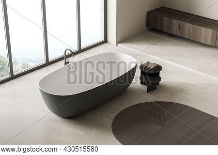 Top View On Bright Bathroom Interior With Bathtub, Panoramic Window, Carpet, Concrete Floor, Pump An