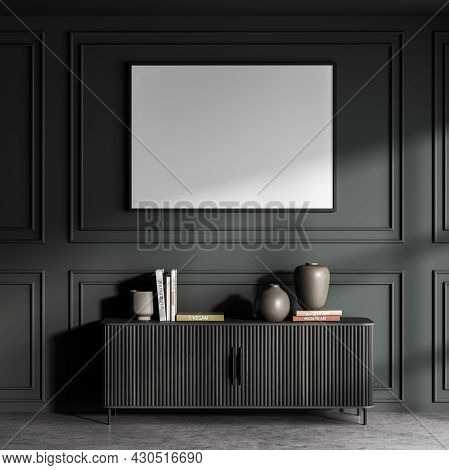 Horizontal White Poster In A Dark Green Area With Wall Moulding And Sideboard With Wood Top Panels.