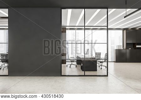 Black Framed Glass Wall Partitions With Accent Grey Details, Led Linear Lights, Concrete Floor And W