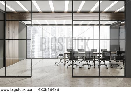 Corridor With Half Empty Panoramic Grey Conference Room Behind The Two Framed Glass Wall Partitions.