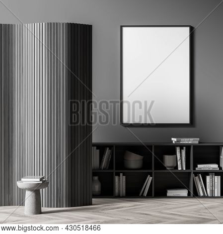 Dark Living Room Interior With White Empty Poster, Coffee Table, Bookshelf, Wooden Partition And Oak