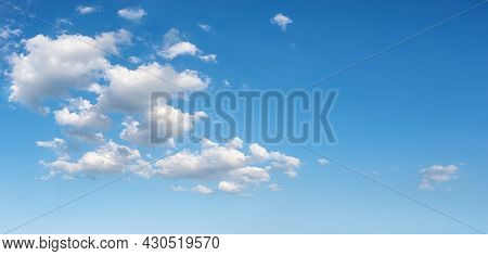 Beautiful Spring Sky With Few White Fluffy Clouds On A Sunny Day. Clear Bright Blue Summer Sky For W