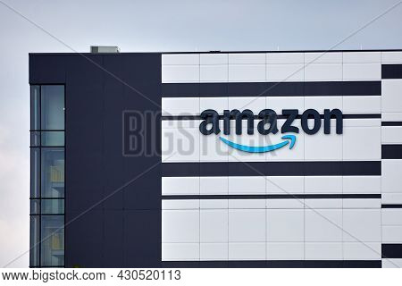 Ottawa, Ontario, Canada - August 13, 2021: The Amazon (nasdaq: Amzn) Logo On The Side Of A New Wareh