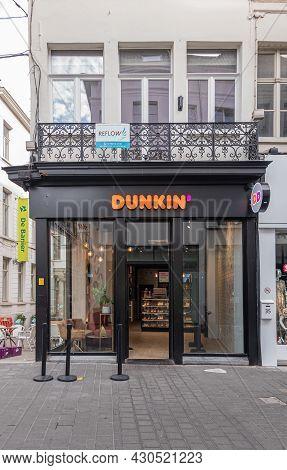 Gent, Flanders, Belgium - July 30, 2021: Dunkin Donuts Store Black And Window Facade On Corner Showi