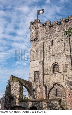 Gent, Flanders, Belgium - July 30, 2021: South-east Corner Of Gray-brown Wall And Tower Of Medieval