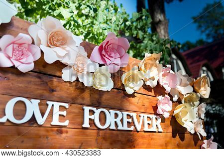 Inscription Love Forever On Wooden Boards. Beautiful Wedding Wooden Arch. Wedding Day. Wedding Conce