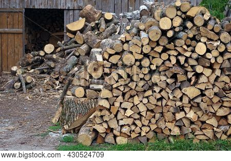 Firewood Warehouse. Chopped Firewood Of Fruit Trees. Pile Of Stacked Firewood