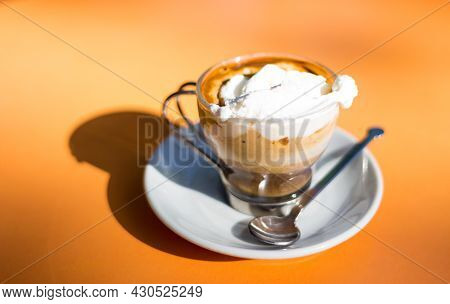Italian Espresso Coffe With Cream On A Table Outside A Bar In Italy In A Sunny Day