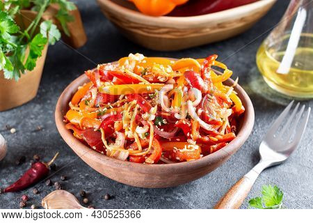 Sweet Peppers With Korean Carrots, Sesame Seeds And Vegetables In A Bowl On A Dark Background. Spicy