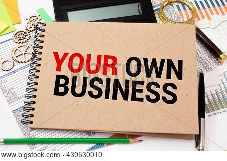 Your Own Business Note Paper Pinned On Cork Board