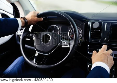 Man Driving His Car, Closeup View Of Hands On Steering Wheel