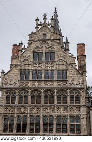 Gent, Flanders, Belgium - July 30, 2021: Facade Top Of Huis Van De Vrije Schippers (house Of The Fre