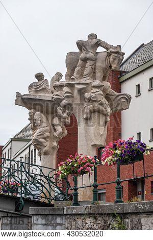 Gent, Flanders, Belgium - July 30, 2021: Beige Stone Statue Along Lieve River Called Brug Der Keizer