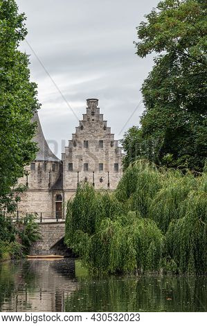 Gent, Flanders, Belgium - July 30, 2021: Beige Stone Medieval Fortification On Lieve River To Contro