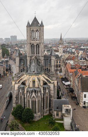 Gent, Flanders, Belgium - July 30, 2021: Historic Medieval Sint Niklaas Church Building Under Rainy