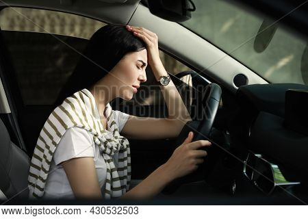 Stressed Young Woman Driver's Seat Of Modern Car