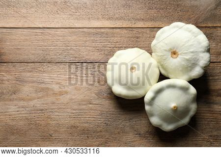 Fresh Ripe White Pattypan Squashes On Wooden Table, Flat Lay. Space For Text