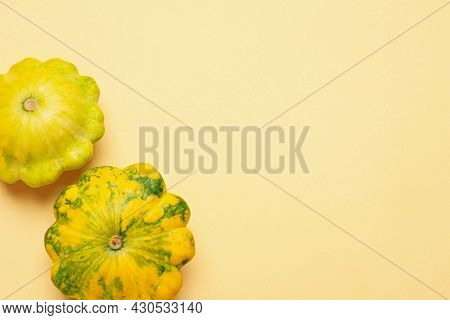 Fresh Ripe Pattypan Squashes On Beige Background, Flat Lay. Space For Text