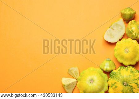 Fresh Ripe Pattypan Squashes On Orange Background, Flat Lay. Space For Text