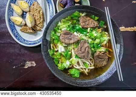 Taiwan Beef Noodle, A Close Up Of Taiwanese Tradition Seasoned Soup Beef Noodles With Vegetable In F