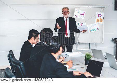 Senior Leader Speaker Speaks To Public People Audience In Training Workshop Or Conference. Mature Le