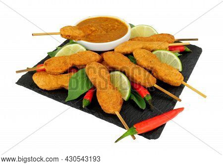 Chicken Satay Skewers With Peanut Dipping Sauce On A Slate Serving Board