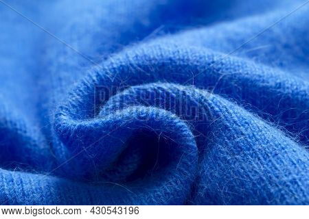 Background Texture Of Blue Pattern Knitted Fabric Made Of Cotton Or Wool Or Angora Close Up.