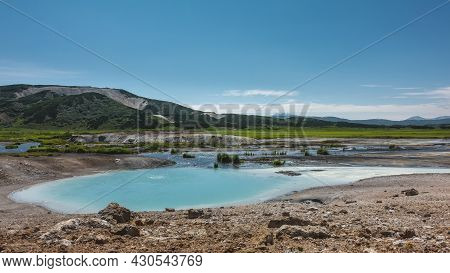 An Amazing Turquoise Geothermal Lake In The Caldera Of An Extinct Volcano. There Is Almost No Vegeta