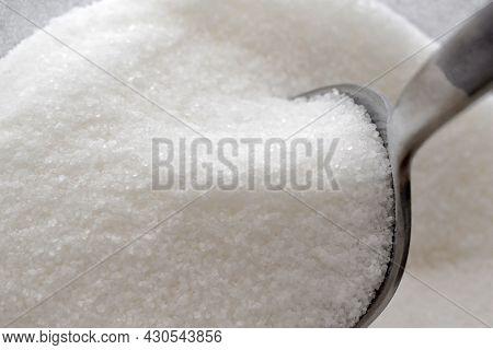 Refined White Sugar In A Glass Jar.