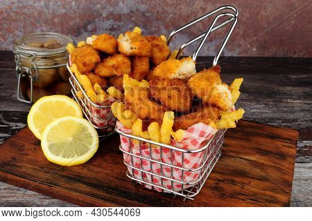 Scampi And French Fries Meal In Wire Serving Baskets With Tartar Sauce