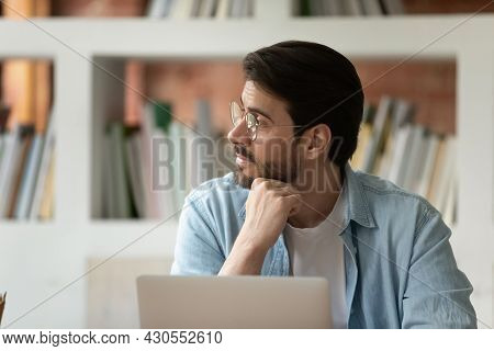 Concerned Thoughtful Businessman Sit At Desk Thinking Looking Away