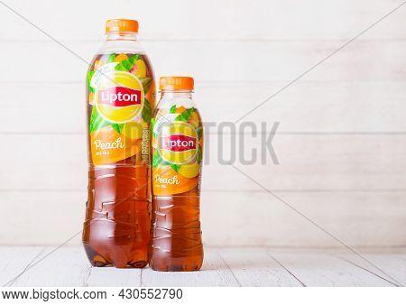 London, Uk - September 03, 2018: Plastic Bottles Of Lipton Ice Tea With Peach Flavour On Wood.
